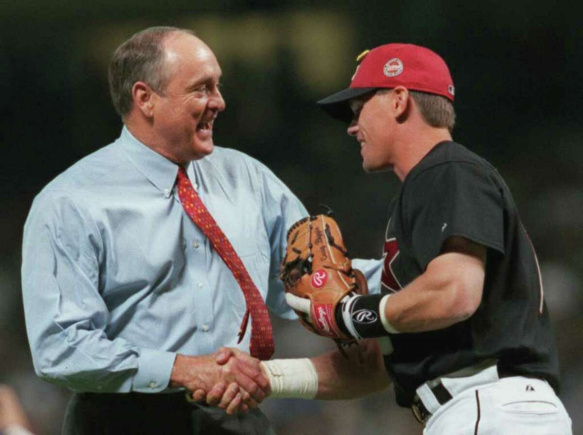 Hall of Famer Nolan Ryan shakes hands with Craig Biggio after throwing the first pitch before the start of the inaugural game between the Astros and Yankees 3/30/2000. Chronicle/Smiley N. Pool.