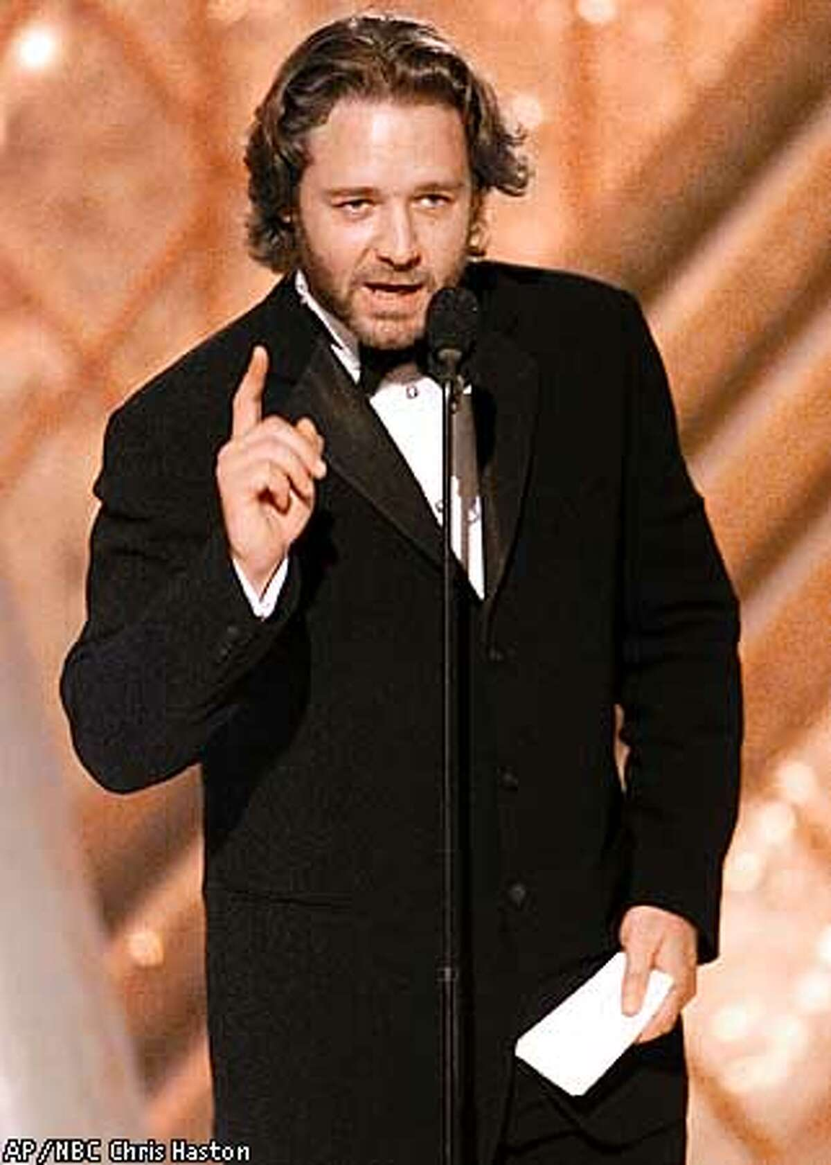 """Actor Russell Crowe accepts his award for best actor in a dramatic motion picture for his work in """"A Beautiful Mind"""" at the 59th Annual Golden Globe Awards in Beverly Hills, Calif., Sunday, Jan. 20, 2002. (AP Photo/NBC, Chris Haston)"""