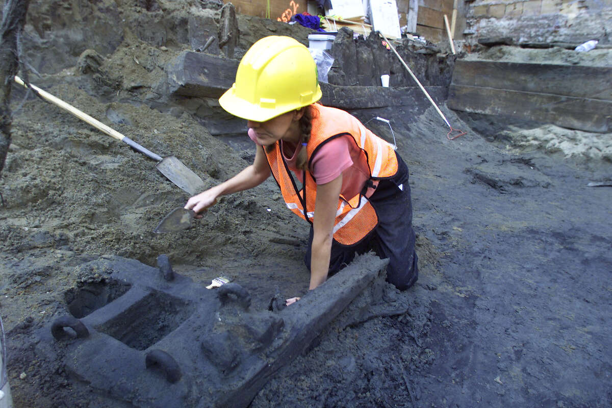 Julie Kirkenslager archaelogist working in the hull of the The General Harrison ship uncovered at 425 Battery St. SF by Vince Maggiora