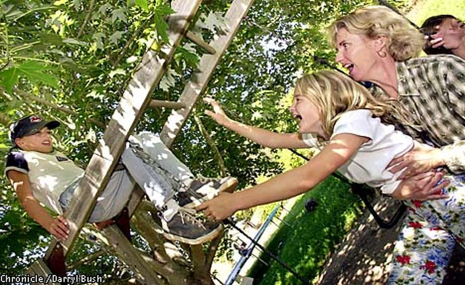 Taylor (girl), top left, and Chloe, both 10, play with mom, Shelley Tushar in the backyard of their La Selva Beach home. Chronicle Photo by Darryl Bush Photo: Darryl Bush