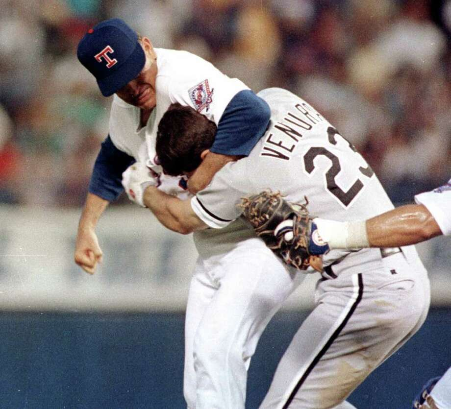 Texas Rangers pitcher Nolan Ryan hits Robin Ventura of the Chicago White Sox after he charged the mound on Aug. 4, 1993 in Arlington, Texas.See more photos from Ryan's epic career in baseball... Photo: LINDA KAYE, AP / AP