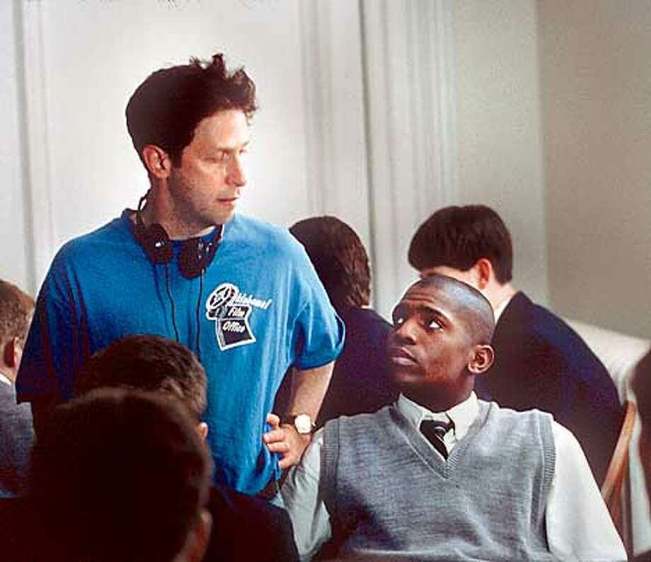 """Director Tim Blake Nelson (left, with actor Mekhi Phifer on the set of """"O"""") says, """"I want to look for . . . a film that's like an extraordinary novel, not an airport read."""""""