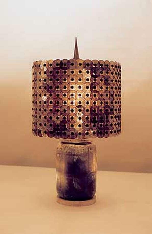 MICHALE MCEWEN LIGHTING STUDIO  TABLE LAMP, 1998  BRONZE, MUSCOVITE MICA, TRAVERTINE Photo: HANDOUT