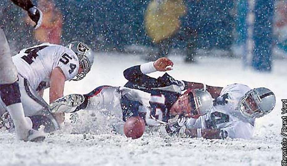 The Patriots Tom Brady fumbled the ball in the fourth quarter, but it was ruled that it was a forward pass and the Patriots got the ball again...a big break for New England. By Brant Ward/Chronicle Photo: BRANT WARD