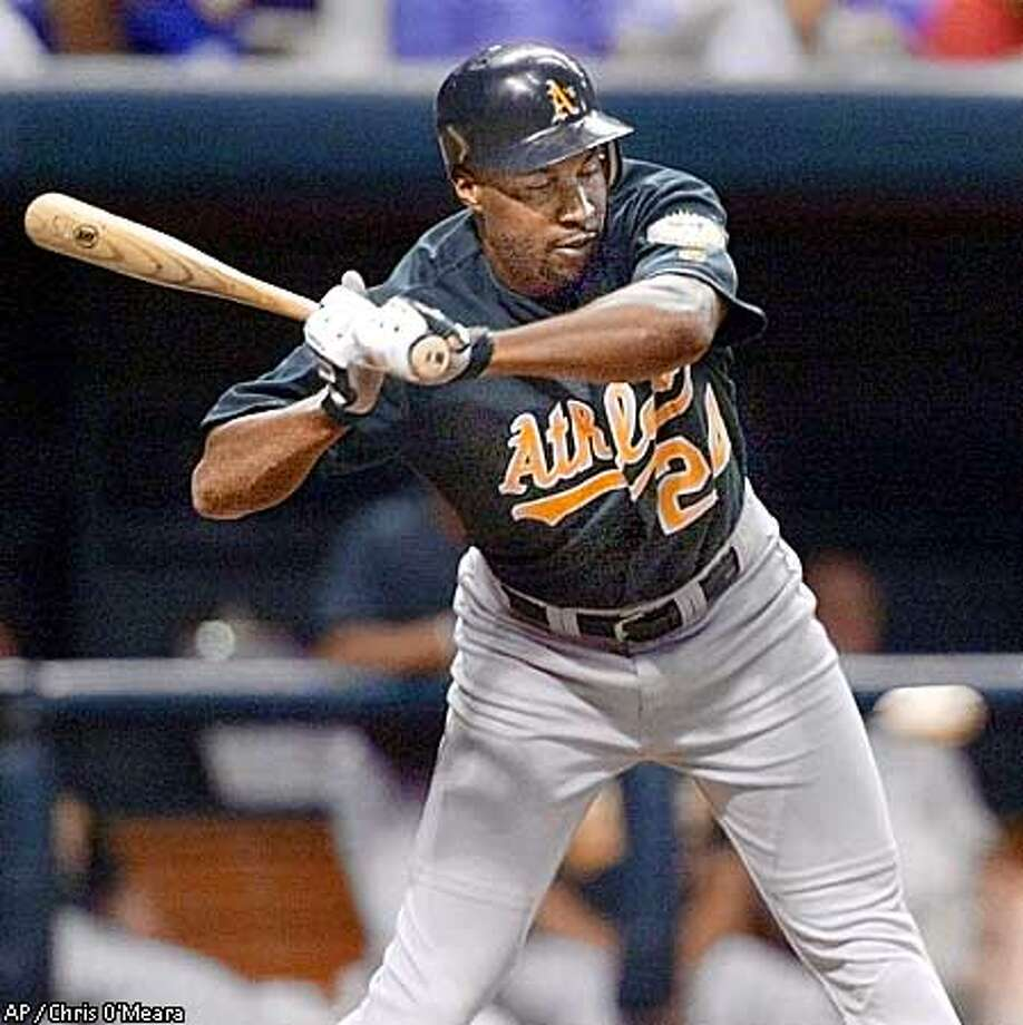Oakland Athletic's batter Jermaine Dye backs away from a called third strike from Tampa Bay Devil Rays pitcher Bryan Rekar during the third-inning Friday night, Aug. 31, 2001 at Tropicana Field in St. Petersburg, Fla. (AP Photo/Chris O'Meara) Photo: CHRIS O'MEARA