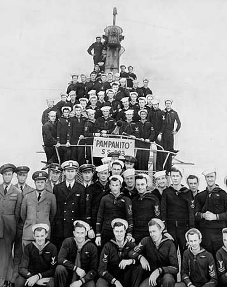 """A painting of the crew of the Pampanito on the building on pier 45 .The USS Pampanito, a submarine that is now a floating museum, docked at Pier 45on Fisherman's Wharf in S.F. After 18 years of service as a floating museum of World War II submarine history, the USS Pampanito will finally be upgraded this Memorial Day weekend with an audio tour that lets people understand just what happened on this historic fighting boat in the big war. This submarine sank five Japanese ships and helped rescue 175 British and Australian prisoners of war during the war, and the director/writer of the current hit movie, """"""""U-571'' was inspired to write his blockbuster by touring the Pampanito. by Vince Maggiora ALSO RAN 5/31/2000 Photo: VINCE MAGGIORA"""