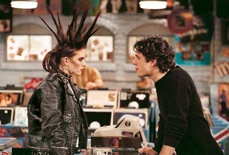 Corey (Glenn Howerton, right) meets his match in Tuesday (Chyler Leigh, left) on the premiere of THAT '80s Show Wednesday, Jan. 23 (8:00-8:30 PM ET/PT) on FOX.  Copyright: 2001/FOX. HANDOUT.