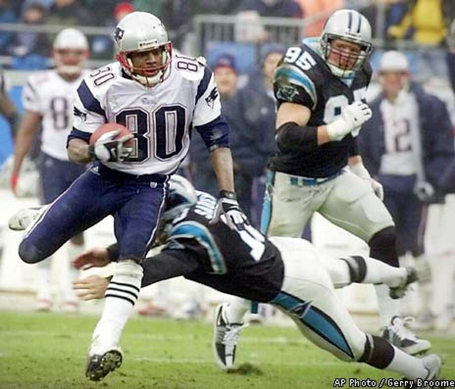 New England Patriots' Troy Brown (80) gets past Carolina Panthers punter Todd Sauerbrun (10) for a 68-yard punt return for a touchdown as Panthers' Dean Wells (95) follows the play during the Patriots' 38-6 win in Charlotte, N.C., Sunday, Jan. 6, 2002. The Patriots clinched the AFC East, while the Panthers earned an ignominious spot in NFL history with 15 straight defeats. (AP Photo/Gerry Broome) Photo: GERRY BROOME