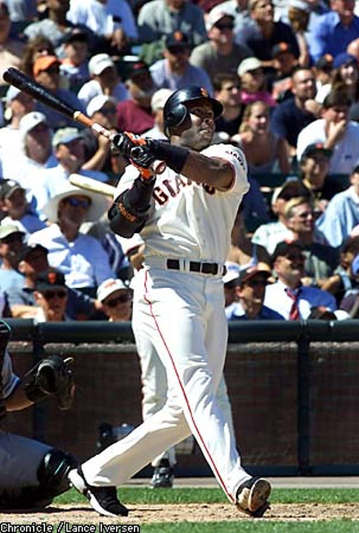 Barry Bonds follows the flight of his 8th inning three run homer over the 421 mark in center field thursday. Giants win over the Florida Marlins 5-3. BY LANCE IVERSEN/SAN FRANCISCO CHRONICLE