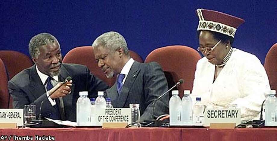 South Africa President Thabo Mbeki, left, talks to United Nations Secretary-General Kofi Annan, center, and South Africa Foreign Minister Nkosazana Dlamini-Zuma during the opening ceremony of the World Conference Against Racism in Durban, South Africa, Friday Aug. 31, 2001. The conference began Friday with a call by Annan for nations to put aside their squabbles and work together to fight discrimination. (AP Photo/Themba Hadebe) Photo: THEMBA HADEBE
