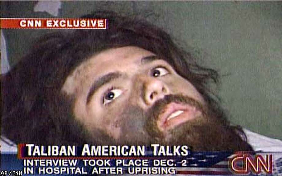 ADVANCE FOR TUESDAY, JAN. 1 AND THEREAFTER--FILE--In this image from television broadcast Wednesday, Dec. 19, 2001, American Taliban fighter John Walker Lindh is seen during an interview soon after his capture. According to CNN, the interview took place Dec. 2, 2001. (AP Photos/CNN)