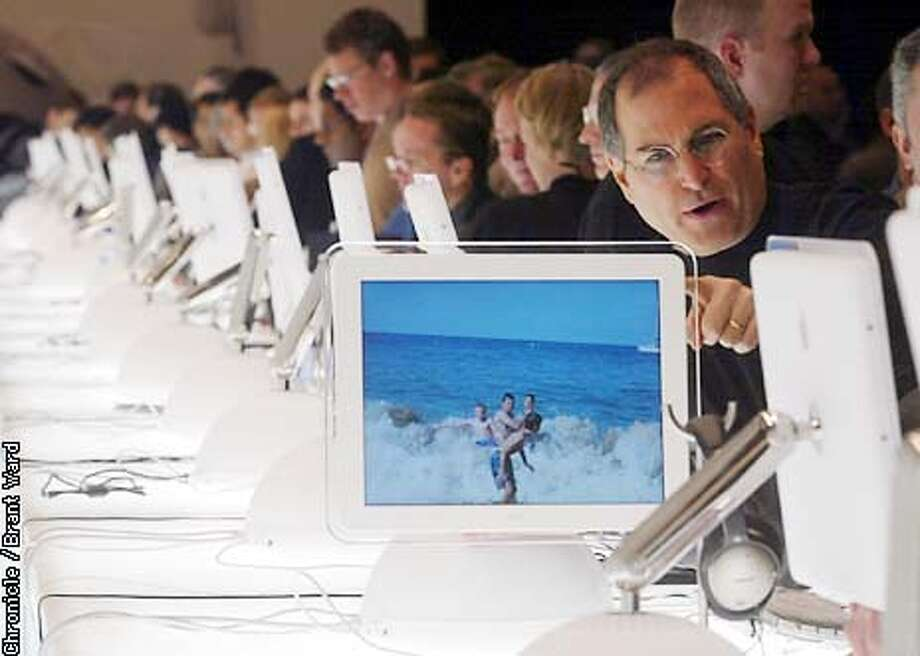Steve Jobs, right, showed some friends the qualities of the new iMac computer unveiled Monday at MacWorld in San Francisco. After his keynote address, Apple co-founder and CEO Steve Jobs mingled with the people looking at the newest offering from Apple. By Brant Ward/Chronicle Photo: BRANT WARD