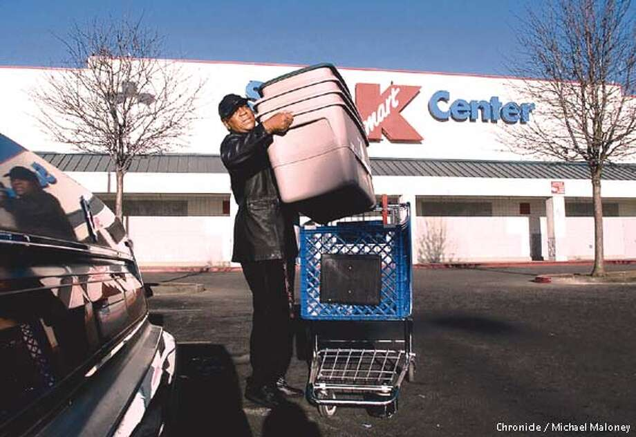 Kmart, the nations 3rd largest discount retailer filed for Chapter 11. Cathleen (cq) Harris of Oakland loads some plastic containers in her car outside the Oakland Super Kmart Center this morning. CHRONICLE PHOTO BY MICHAEL MALONEY Photo: MICHAEL MALONEY