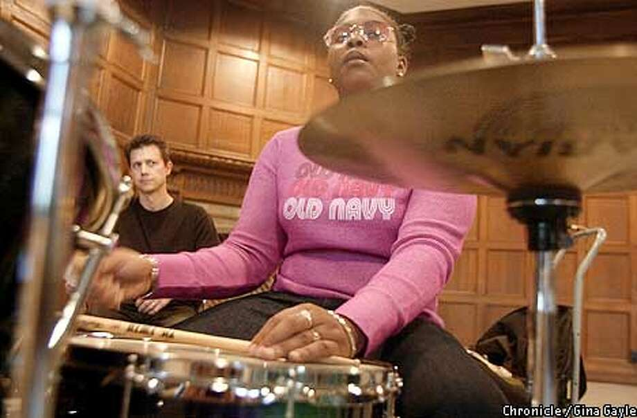 Ruthie Price plays drums as drumming coach Brian Rice watches her form during a rehearsal with the Oaktown Jazz Workshop at the Alice Arts Center. Photo by Gina Gayle/The SF Chronicle. Photo: GINA GAYLE