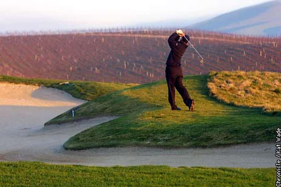 LIVERMOREa-C-10JAN02-TR-KW - As the sun sets on a backdrop of vineyards, Drake Jones of San Mateo plays the sixth hole of the Chardonay course at Poppy Ridge Golf Course inLivermore. ( SAN FRANCISCO CHRONICLE PHOTO BY KAT WADE)