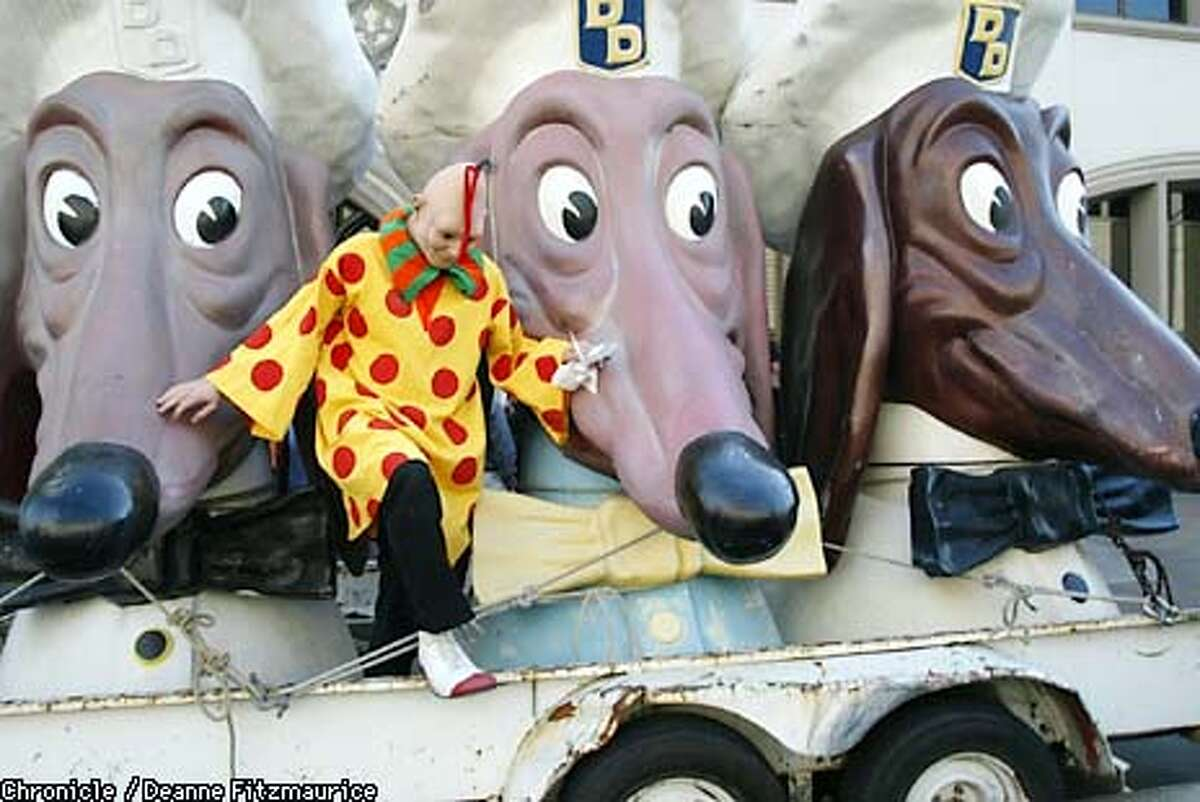 A man dressed as Zippy the Pinhead jumps off a flatbed truck carrying three Doggie Diner heads in front of the San Francisco Chronicle. It was announced today that the Zippy comic will be brought back to the Chronicle after being briefly discontinued. CHRONICLE PHOTO BY DEANNE FITZMAURICE