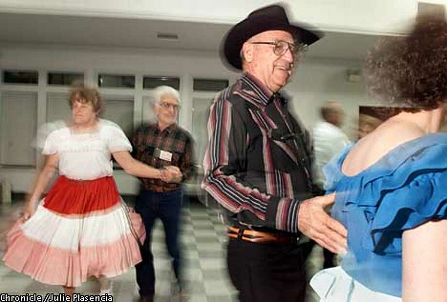 Tom Burns of Concord, a ten year square dancing veteran, helps out the new comers during a square dancing workshop at the Pacheco Community Center in Pacheco. (JULIE PLASENCIA/THE CHRONICLE) Photo: JULIE PLASENCIA