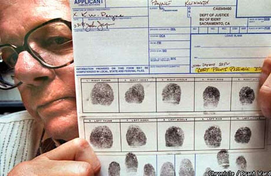 FINGERS/15APR98/CD/WARD--Ken Payne holds a copy of his fingerprints, which the state claims are not clear enough for him to teach anymore. By Brant Ward/Chronicle