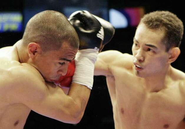 Nonito Donaire, right, of the Philippines connects a punch against Raul Martinez, left, of Mexico during their IBF flyweight title bout in suburban Quezon City, north of Manila, Philippines on Sunday April 19, 2009. Donaire retained his crown to win via technical knock out as the referee stopped the fight on the fourth round. Photo: Aaron Favila, AP / AP