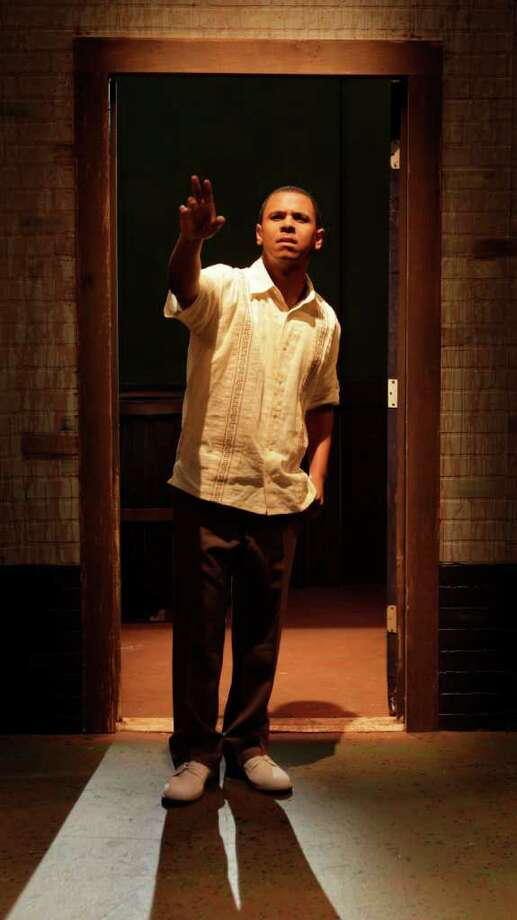 "Joseph Palmore has the title role in The Ballad of Emmett Till, playing at the Ensemble Theatre. Ifa Bayeza's play is based on the notorious 1955 ""hate crimes"" case of a Chicago youth murdered whle visiting relatives in rural Mississippi. Photo: Melissa Phillip / © 2011 Houston Chronicle"