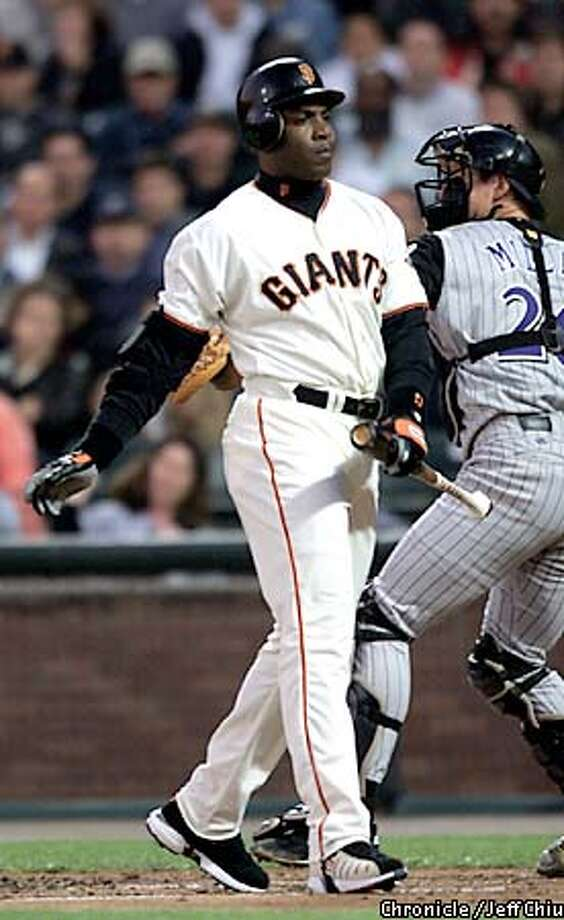 Barry Bonds reacts after striking out in the first inning as the Giants play the Arizona Diamondbacks at Pac Bell Park on Wednesday night. Photo by Jeff Chiu / The Chronicle. Photo: Jeff Chiu