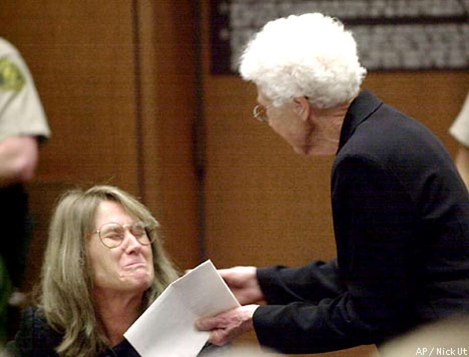 Former Symbionese Liberation Army fugitive Sara Jane Olson, left, weeps as her mother, Elsie Soliah, comes over to embrace her after speaking on Olson's behalf during a sentencing hearing Friday, Jan. 18, 2002, in Los Angeles. With friends and family sobbing in the courtroom, Olson was sentenced to 20 years to life in prison for conspiring to blow up police cars in 1975. Immediately afterward, Olson pleaded innocent to robbery and murder charges in another decades-old crime: the 1975 SLA bank holdup in which a bystander, Myrna Opsahl, was killed. (AP Photo/Nick Ut) Photo: NICK UT