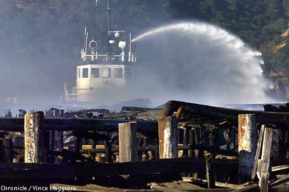 Sea Wolf fire boat from the city of Oakland pouring water on the Fire at the Benicia industries pier east of downtown Benicia by Vince Maggiora Photo: VINCE MAGGIORA