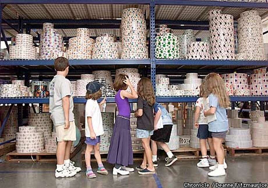 "Children admire stickers during a tour of ""Mrs. Grossman's"" decorative sticker company in Petaluma, one of the largest such companies in the world.  CHRONICLE PHOTO BY DEANNE FITZMAURICE Photo: DEANNE FITZMAURICE"