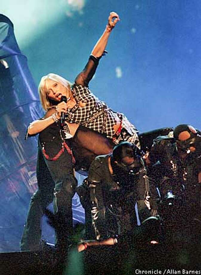 Madonna performs at the Palace, Auburn Hills Mi on 8.25.01. Photo by Allan Barnes