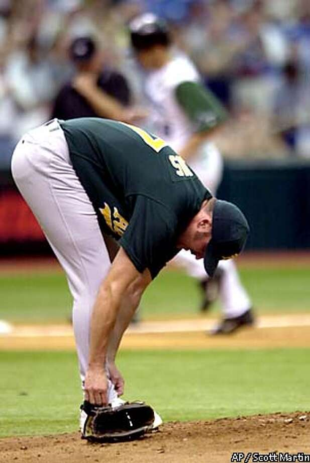 Oakland Athletics starter Erik Hiljus adjusts his pants on the mound after giving up a two-run homer to Tampa Bay Devil Rays' Steve Cox, background, in the first inning Saturday, Sept. 1, 2001 at Tropicana Field in St. Petersburg, Fla. (AP Photo/Scott Martin) Photo: SCOTT MARTIN