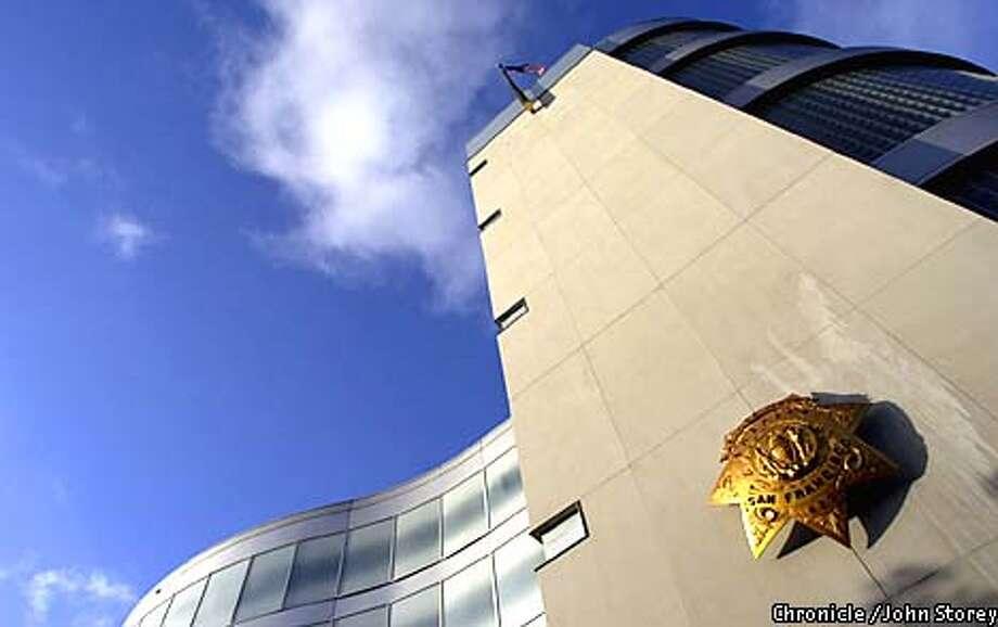 NEIGHBOR02-C-30JUL01-MG-JRS-The neighborhood around the Hall of Justice. The Sheriff's Badge on the Sheriff's Building. Chronicle photo by John Storey. Photo: John Storey