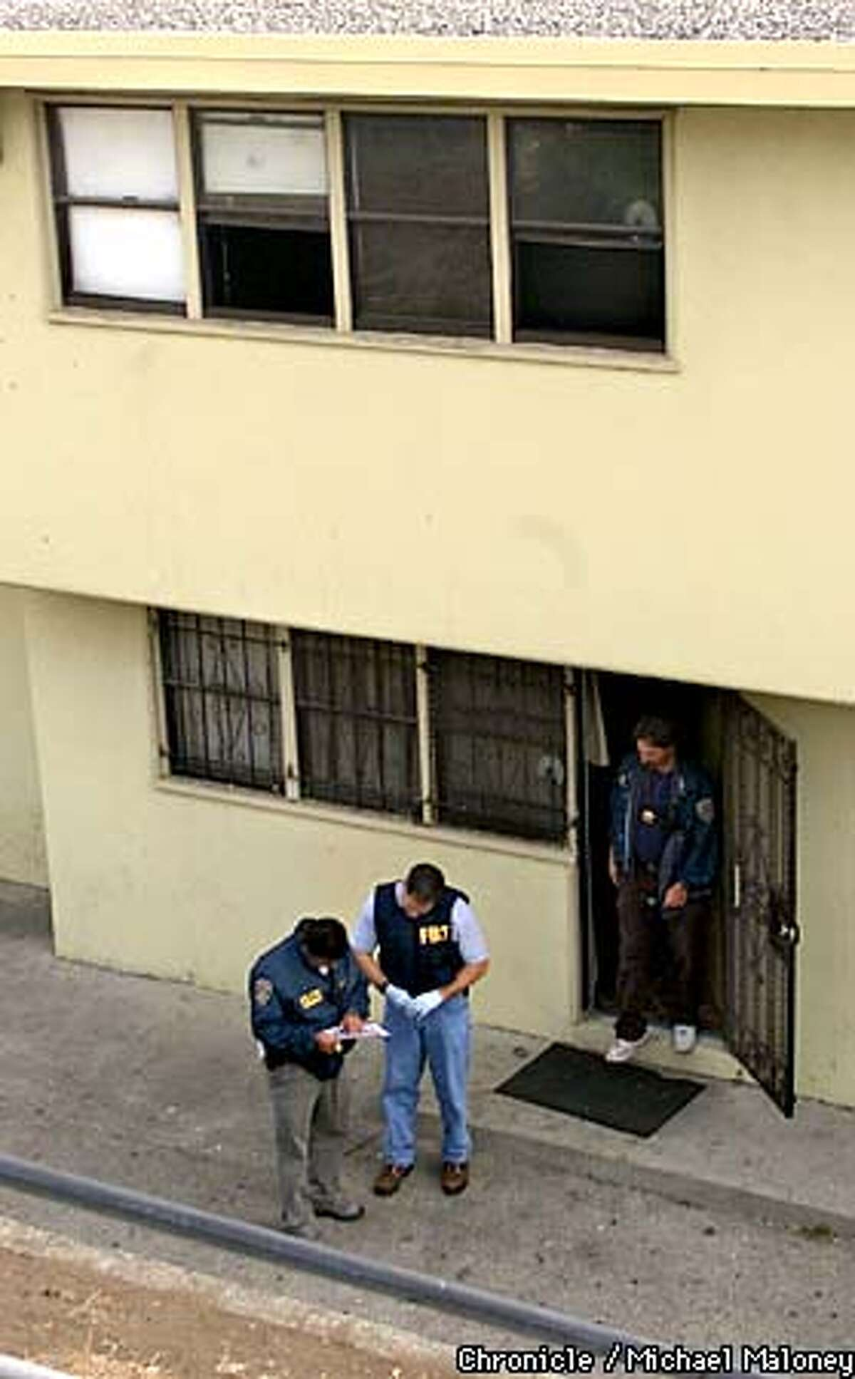 FBI and SFPD officers search an apartment at 38 Harbor Road in the Hunters Point area of SF. Starting at 6am this morning, nearly 200 FBI and bay area police officers carried out numerous search and arrest warrants to apprehend drug and weapons violators in SF and other bay area cities. CHRONICLE PHOTO BY MICHAEL MALONEY