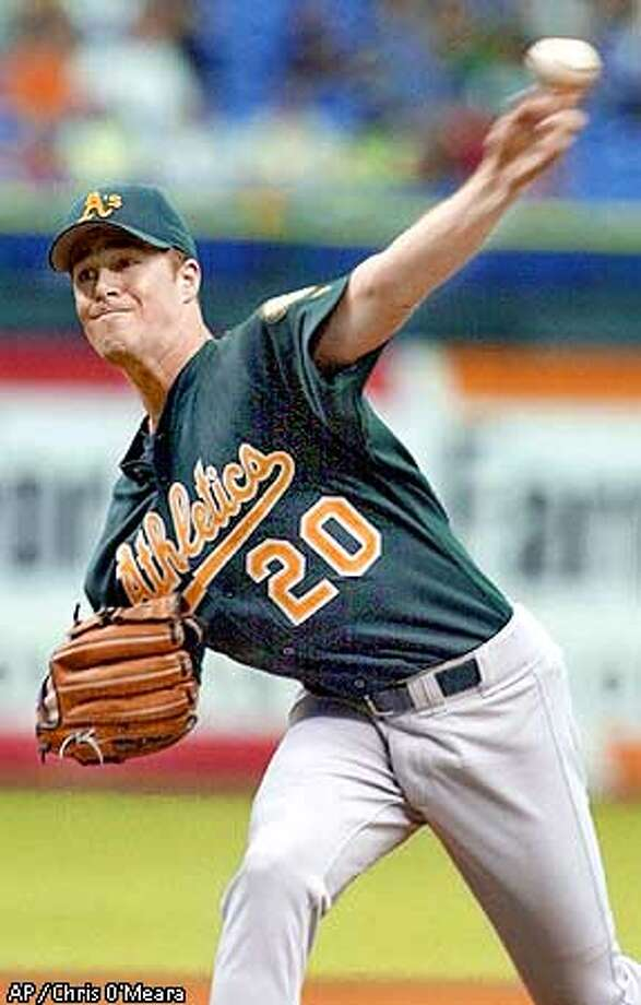 Oakland Athletics pitcher Mark Mulder throws a second inning pitch to Tampa Bay Devil Rays batter Steve Cox Sunday afternoon Sept. 1, 2001 at Tropicana Field in St. Petersburg, Fla. Mulder pitched a complete game giving up one-run on four hits. The A's won the game 3-1. (AP Photo/Chris O'Meara) Photo: CHRIS O'MEARA