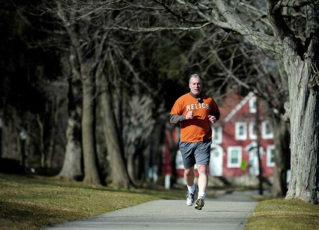Kevin Russo wears shorts while jogging through Milford, Conn. thanks to unseasonably mild temperatures Tuesday, Jan. 31, 2012. Photo: Autumn Driscoll / Connecticut Post