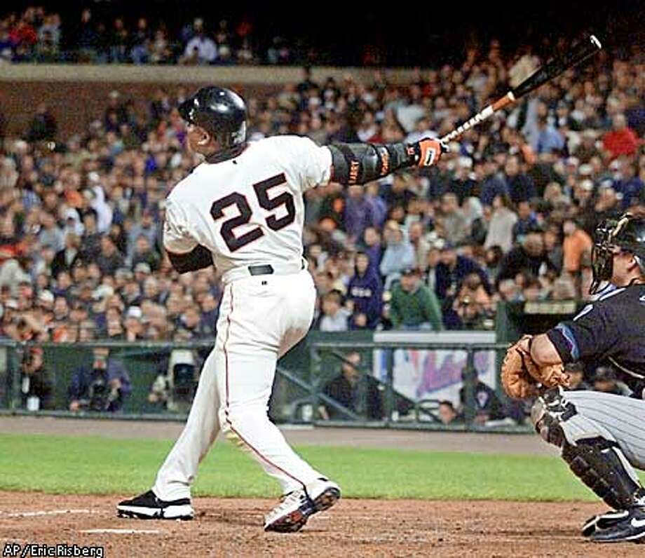 San Francisco Giants' Barry Bonds follows his 59th home run of the season after hitting it off Arizona Diamondbacks' pitcher Miguel Batista during the 7th inning in San Francisco, Tuesday, Sept. 4, 2001. The Giants won the game, 5-2. (AP Photo/Eric Risberg) Photo: ERIC RISBERG