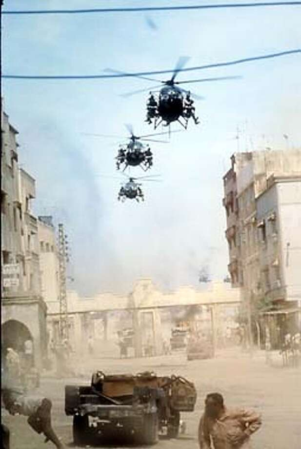 American soldiers arrive in Mogadishu in black hawk and Little bird helicopters in the Columbia Pictures film Blackhawk Down. HANDOUT.