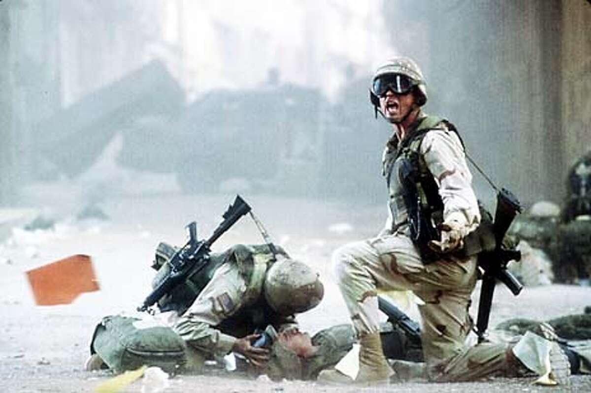 Josh Hartnett (right) plays Eversmann and Orlando Bloom (center) plays Blackburn in the Columbia Pictures/Revolution Studios presentation, Black Hawk Down.
