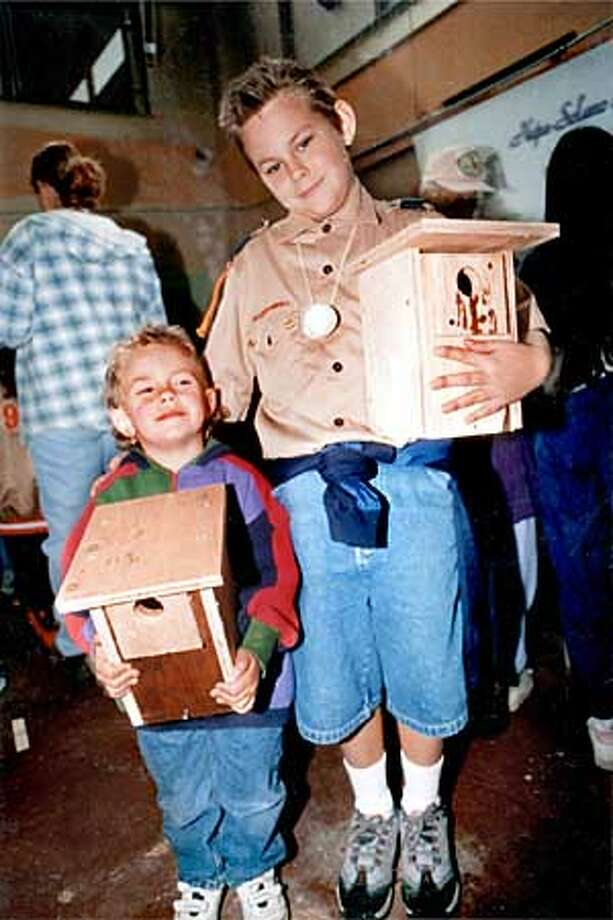 Two youthful clients at a birdbox building workshop pose proudly with their products at the Mare Island Flyway Festival. Photo: HANDOUT