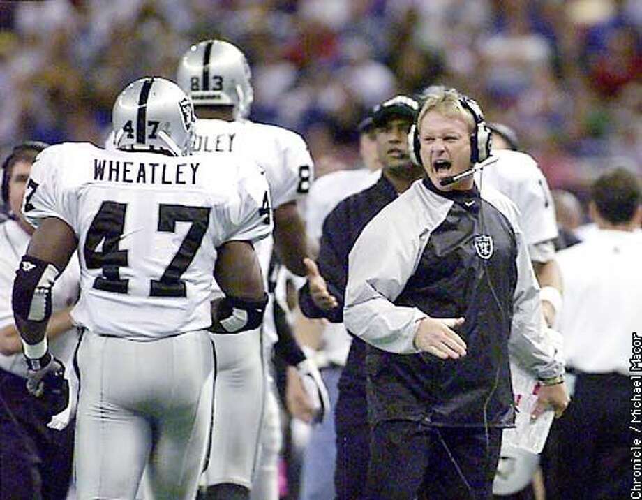 Oakland Raidersv. Seattke Seahawks. First quarter TD by 47- Tyrone Wheatley goes in from 7 yards out returns to the bench and a happy coach Jon Gruden waits to congratulate. by Michael Macor/The Chronicle ALSO RAN 12/24/2000 Photo: MICHAEL MACOR