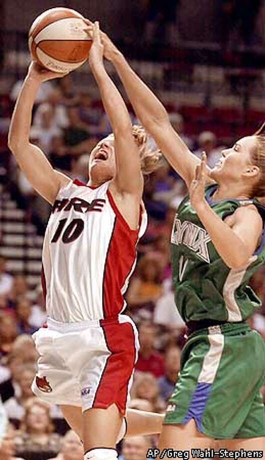 Portland Fire's Jackie Stiles (10) has her shot blocked by Minnesota Lynx's Erin Buescher (11) during the first half in Portland, Ore., Wednesday, Aug. 8, 2001. (AP Photo/Greg Wahl-Stephens) Photo: GREG WAHL-STEPHENS