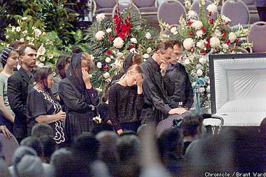 Family members of the slain Ukranians could not hide their grief as they looked into six coffins at the Bethany Slavic Church outside Sacramento Sunday. A memorial service and buriel was attended by over 5000 people. These are believed to be part of the Boris and Zoya Kukharskiy family, whose daughter Tanya was killed. By Brant Ward/Chronicle Photo: BRANT WARD