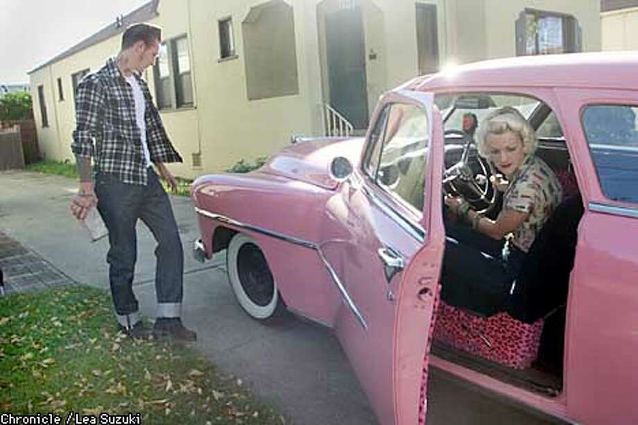 "From right: Gray Harris and Jon Freese. Harris moves the '51 Dodge Coronet down the driveway as Freese looks on. Harris and Freese live and breathe the 50s. They restore cars (including one that was used in Santana's ""Supernatural"" video"", and currently are working on a pink '51 Dodge Coronet. They sport the look and only wear vintage clothes. Photo By Lea Suzuki/San Francisco Chronicle Photo: LEA SUZUKI"
