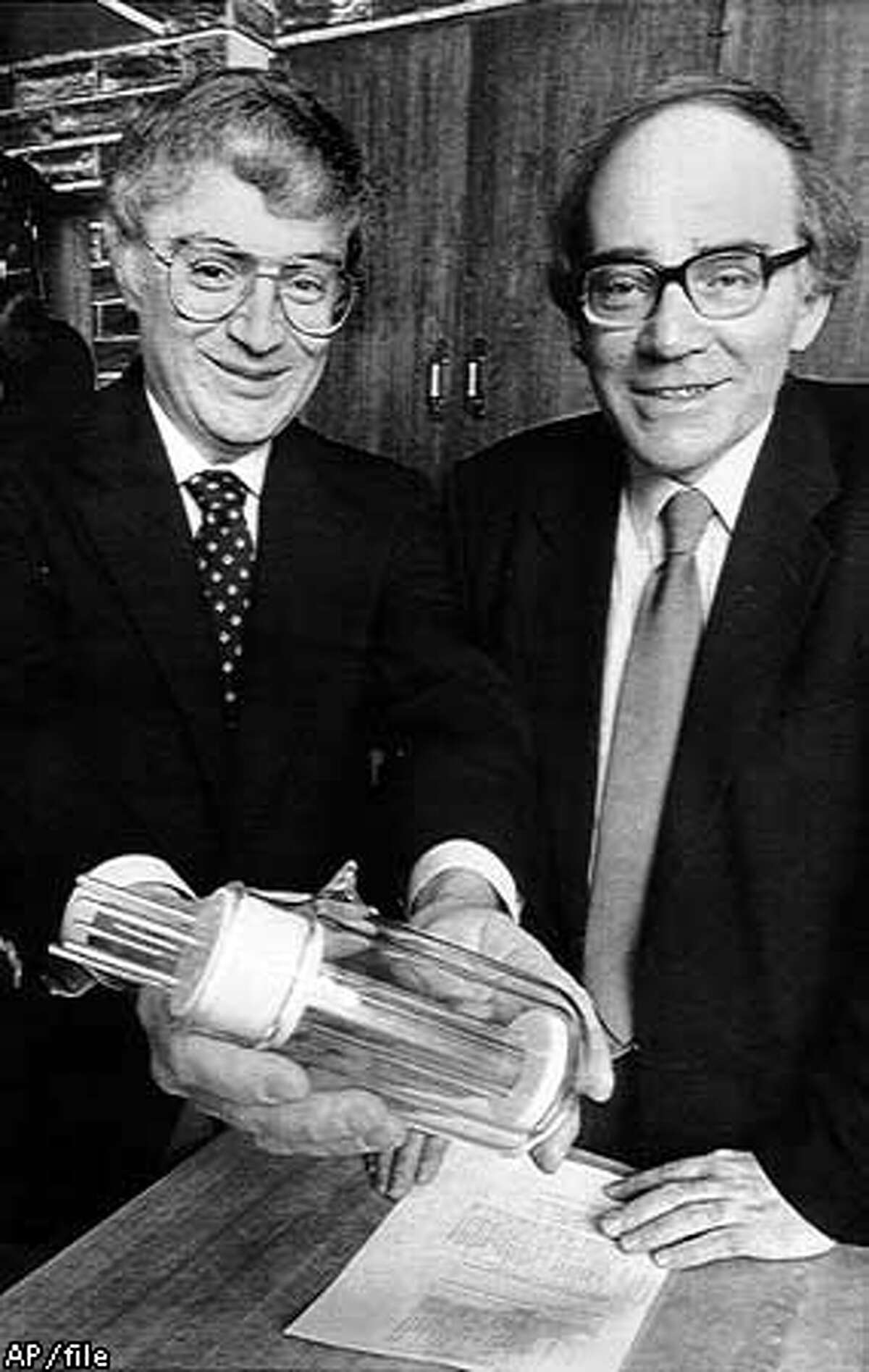 """Utah researchers B. Stanley Pons and Martin Fleischmann displayed a large-scale model of the flask in which they said they created sustained """"cold fusion"""" reaction, a claim undermined by other scientists' experiments. Associated Press File Photo"""
