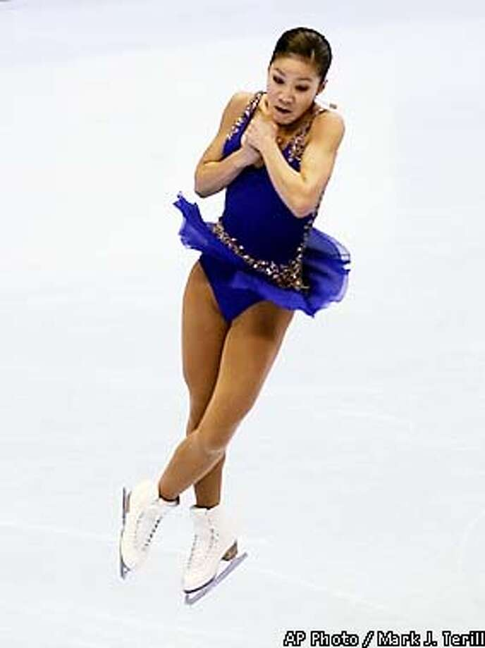Michelle Kwan performs a jump during her short program at the U.S. Figure Skating Championships Thursday, Jan. 10, 2002, in Los Angeles. (AP Photo/Mark J. Terill) Photo: MARK J. TERRILL