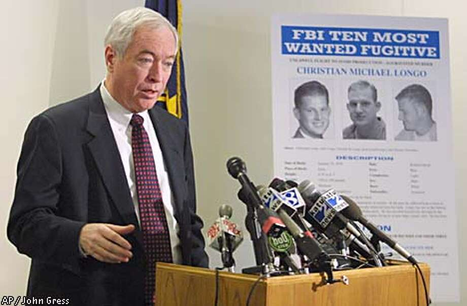 Charles Mathews of the FBI announced the most wanted status of Christian Michael Longo at a press conference in Portland, Ore. Associated Press photo by John Gress