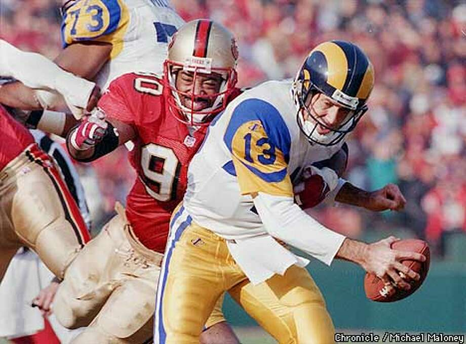 49ERS BRYANT/C/27DEC98/SP/MAC = FOOTBALL / SF 49ERS V. RAMS 49ers 90- Junior Bryant sacks Rams QB 13- Steve Bono in the 2nd quarter, Bono fumbled on the play and was recovered by St. Louis. PHOTO by Michael Maloney/The Chronicle Photo: MICHAEL MALONEY