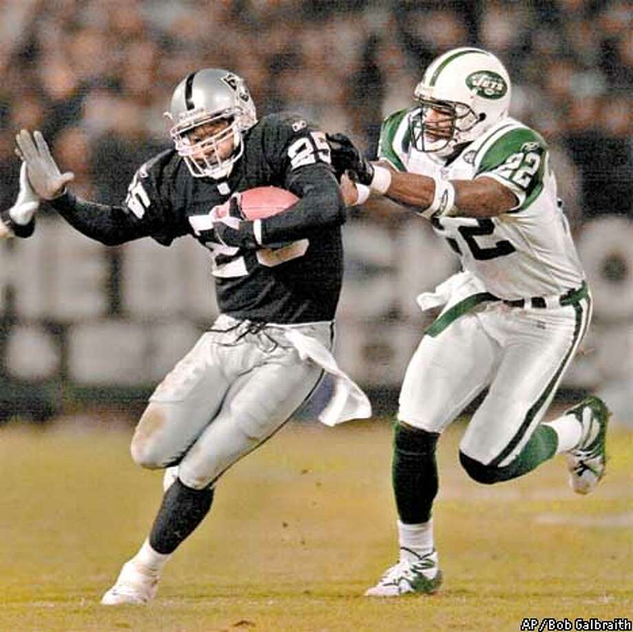 Oakland Raiders' Charlie Garner runs with the ball as he tries to evade New York Jets' Damien Robinson (22) in the second quarter during the AFC Wildcard playoff game in Oakland, Calif., Saturday, Jan. 12, 2002. (AP Photo/Bob Galbraith) Photo: BOB GALBRAITH