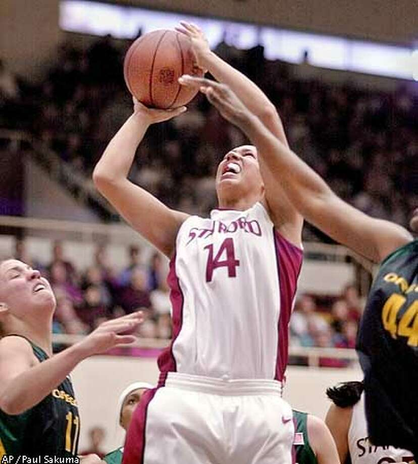Stanford forward Nicole Powell (14) scores in front of Oregon forward Amy Parrish, left, and center Andrea Unaka, right, in the first half, Sunday, Jan. 13, 2002, in Stanford, Calif. (AP Photo/Paul Sakuma) Photo: PAUL SAKUMA