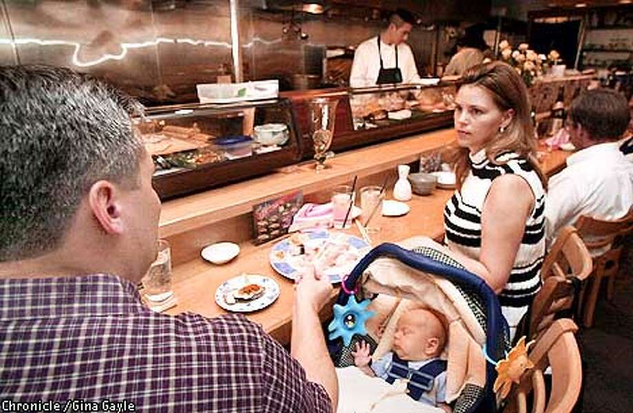 Shun Japanese Bistro is the type of restaurant where Jim and Jannel Gladen can bring their seven week old son Westly and still have a nice evening . Photo by Gina Gayle/The SF Chronicle. Photo: GINA GAYLE