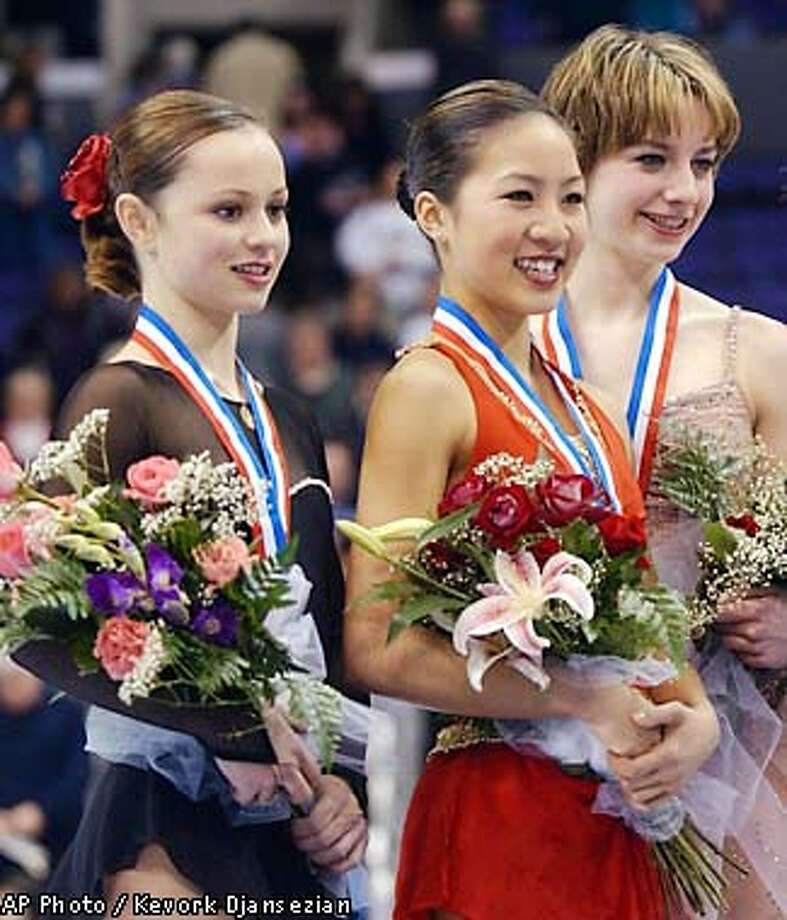 From left, Sasha Cohen, second place, Michelle Kwan, first place, Sara Hughes, third place, and Angela Nikodinov, fourth place, pose with their medals after the U.S. Figure Skating Championships Saturday, Jan. 12, 2002, in Los Angeles. (AP Photo/Kevork Djansezian) Photo: KEVORK DJANSEZIAN